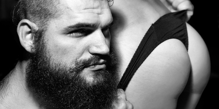 Young sensual couple of handsome man embracing sexy female buttocks in panties closeup Stock Photo
