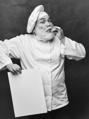 Grimace cook holding blank paper on grey background, copy space