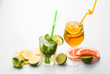 Drink and food. Fruit slice and cocktail glass at bar. Party and summer vacation. Cocktails isolated on white background with mojito. Alcoholic beverage and fruit at restaurant.