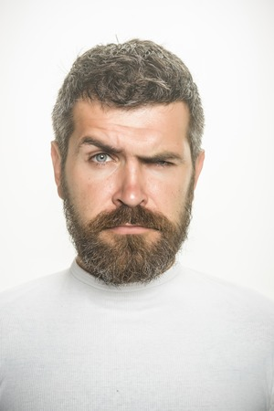 Man with long beard and mustache. Guy or bearded man isolated on white background. Barber fashion and beauty. Feeling and emotions. Hipster with serious face. 版權商用圖片