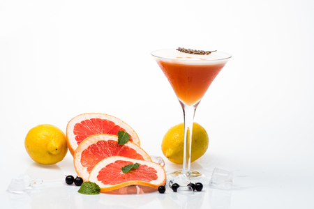 Cocktail isolated on white background. Drink and food. Alcoholic beverage and fruit at restaurant. Fruit slice and cocktail glass at bar. Party and summer vacation.