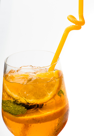 Cocktail isolated on white background. Party and summer vacation. Drink and food. Alcoholic beverage and orange at restaurant. Fruit slice and cocktail glass at bar, copy space