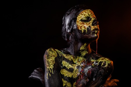 Halloween girl skeleton with flower on chest on black background. Woman with skull face paint drool saliva. Life and death concept. Day of dead celebration. Body painting and art. Stok Fotoğraf