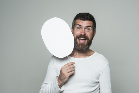 man with long beard on happy face with paper nameplate on grey background, copy space Banco de Imagens