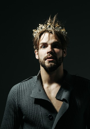 Man or cinderella prince in crown on grey background. Freak, gay and transvestite. Drag queen, homosexual and trans. Fashion, jewelry, accessory. Glory, nobility, triumph concept. Stok Fotoğraf