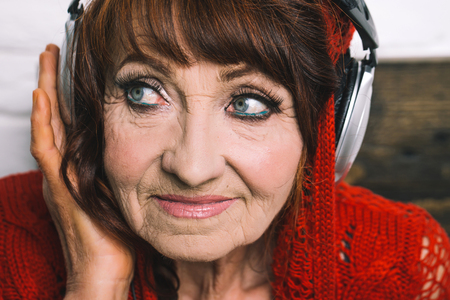 Old woman listen music in headphones. Audio book and new technology, education. music and radio operator. Spy and telephonnist. Granny dj in headset.