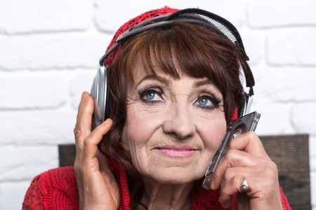 Audio book and new technology, education. music and radio operator. Granny dj in headset. Spy and telephonnist. Old woman listen music in headphones. Stock Photo