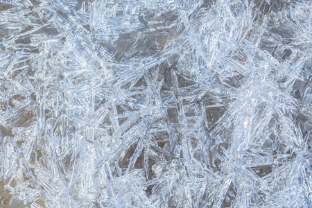 Background with ice frozen texture. Texture of ice surface. Frost crystal border on ice, Christmas backdrop. Christmas, frozen window texture. Winter ice background, new year. Stock fotó