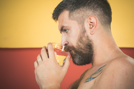 Life source and healthcare. Hangover and thirst. Hipster drink clean healthy water, refreshing. Man with long beard hold water glass on colorful background. Health and dieting.