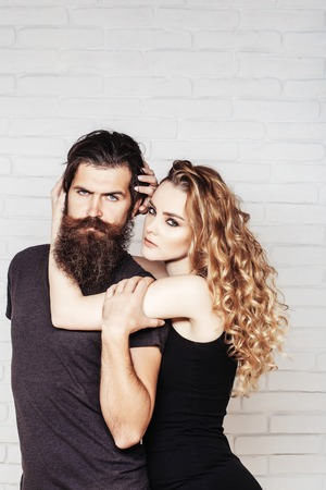 Man with beard and woman with long blond hair. Fashion, beauty, style concept.