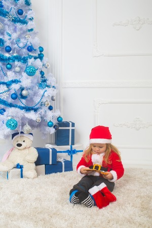 new year small boy at christmas tree winter holiday and vacation santa claus kid