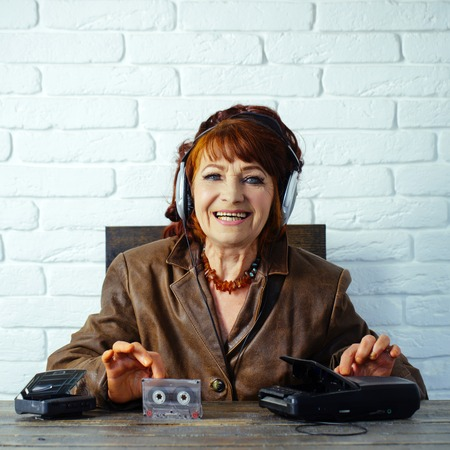 Audio book and new technology, education. Old school music player, radio. happy granny dj in headset with cassette player. Spy and operator. Old woman with cassette recorder listen music in headphones Stock Photo