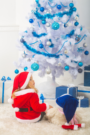 christmas child with bear and gift cyber monday santa claus kid with present box black friday xmas party celebration new year small boy at christmas - Cyber Monday Christmas Decorations