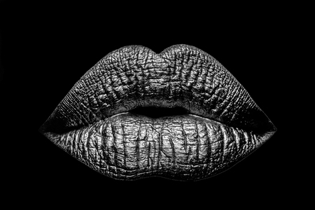 sexy female golden or gold lips isolated on black background as makeup or body art painted mouth metallized color with violet shade Stock Photo