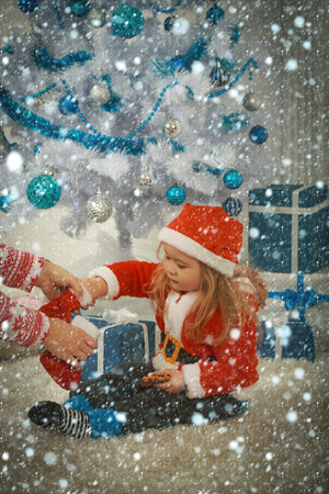 new year christmas snow concept Christmas happy child with bear and gift, cyber monday. Santa claus kid with present box, black Friday. Xmas party celebration. New year small boy at Christmas tree.