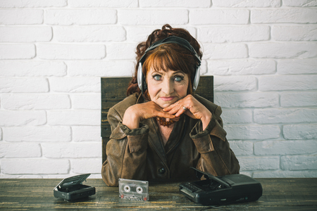 Audio book and new technology, education. Spy and operator. Old school music player, radio. happy granny dj in headset with cassette player. Old woman with cassette recorder listen music in headphones Stock Photo