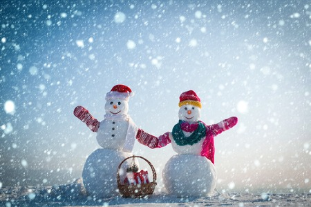 christmas new year snow concept Snowman in winter outdoor with gift box. Xmas or christmas decoration. New year snowman from snow in hat. Happy holiday and celebration. Christmas and boxing day.