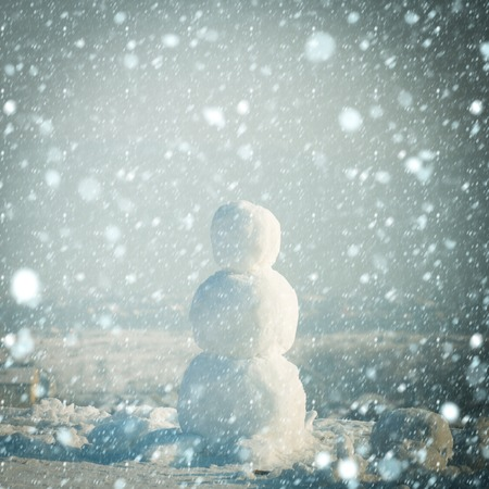 new year christmas snow concept christmas snowman made of white snow in winter sunny outdoor