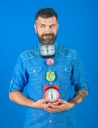 Lifetime, business and deadline. Overtime and urgency. Time management and countdown. smiling man with beard hold alarm clock. Time and perfect morning.