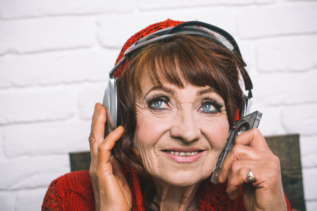 music and radio operator. Spy and telephonnist. happy granny dj in headset. Old woman listen music in headphones. Audio book and new technology, education.