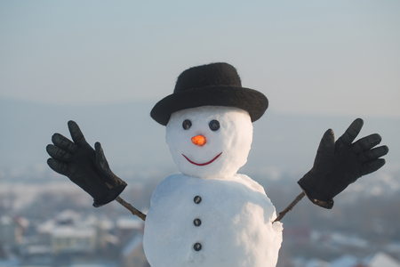 Christmas and winter fashion. Happy holiday celebration. Xmas or christmas party. Snowman gentleman in winter black hat, scarf and gloves. New year snowman spy agent.