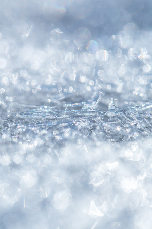 Frost crystal border on ice, Christmas backdrop. Background with ice frozen texture. Texture of ice surface. Christmas, frozen window texture. Winter ice background, new year. blurred, defocused Archivio Fotografico