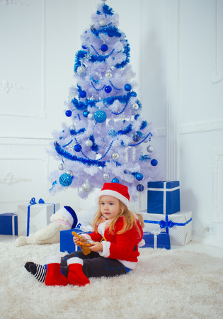 Xmas party celebration. Santa claus kid with present box, black Friday. Winter holiday and vacation. New year small boy at Christmas tree. Christmas happy child with bear and gift, cyber monday.