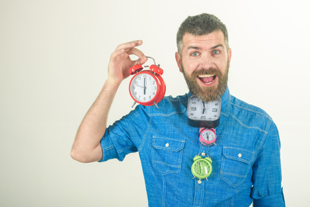 man with beard on happy face hold many alarm clock isolated on white background, time and deadline, lifetime, time management