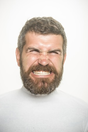 Hipster with scared face. Guy or bearded man isolated on white background. Barber fashion and beauty. Feeling and emotions. Man with long beard and mustache.