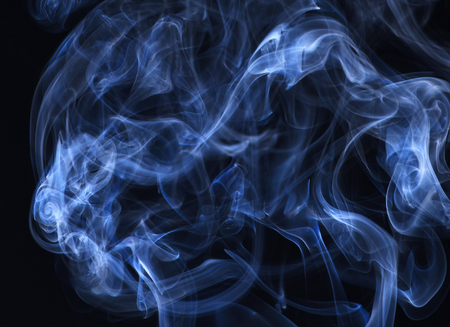 Blue smoke on black background. Abstract background with smoke. Spirit and ghost, miracle. Smoking cloud backdrop. Blue ink in freeze motion, powder splatted explosion.