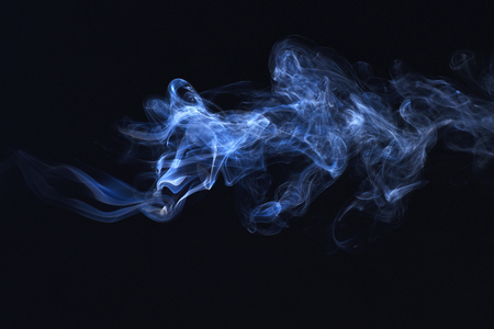 blue smoke on black background, freeze motion of powder splatted explosion. Spirit and ghost, miracle.