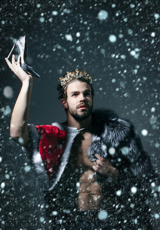 christmas new year snow concept Cinderella prince with shoe on grey background. Freak, gay and transvestite. Freedom and lgbt, kitsch. Drag queen, homosexual and trans.