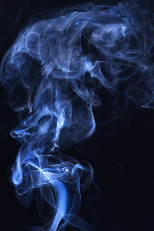 Abstract background with smoke. Blue smoke on black background. Smoking cloud backdrop. Spirit and ghost, miracle. Blue ink in freeze motion, powder splatted explosion.