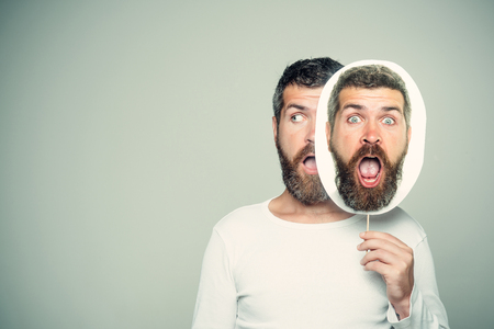 man with long beard on surprised and serious face on portrait nameplate on grey background, copy space Banco de Imagens