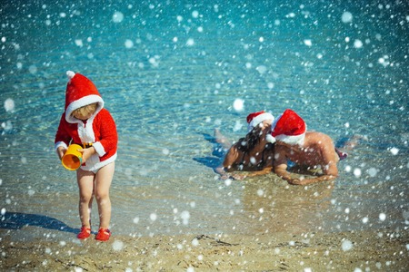 christmas and new year snow concept Winter holiday vacation. Xmas party celebration, fathers and mothers day. Santa child, parents at Christmas. Christmas happy family in water. New year man Stock Photo
