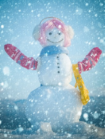 christmas and new year snow concept New year snowman with shopping bag. Happy holiday celebration. Christmas and winter fashion. Snowman girl in winter pink wig hair with bag. Xmas or christmas party.