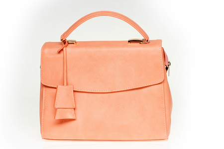 Bag or handbag of coral color, leather material isolated on white background. Fashion, style, accessory concept