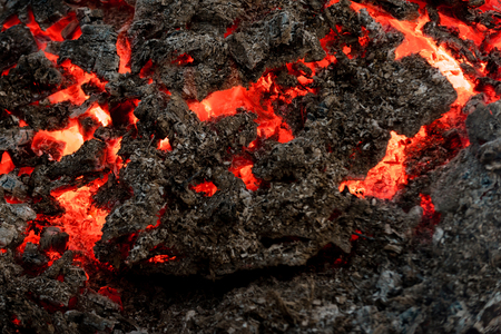 Volcano, fire, crust. Lava flame on black ash background. Danger, hazard, energy concept. Magma textured molten rock surface. Formation, geology, nature, environment. Imagens