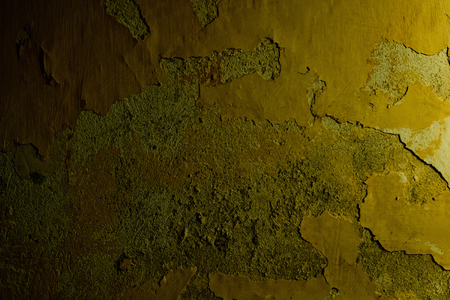 Wall of cement and plaster with cracked surface on yellow background. Damage, architecture, structure, texture concept