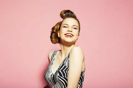 Woman with retro hair and fashionable makeup, pinup. Girl in stylish vintage dress on pink background. Makeup, hairdresser and cosmetics. Beauty and fashion, cosmetics. pinup, youth and look. Stok Fotoğraf - 93012837