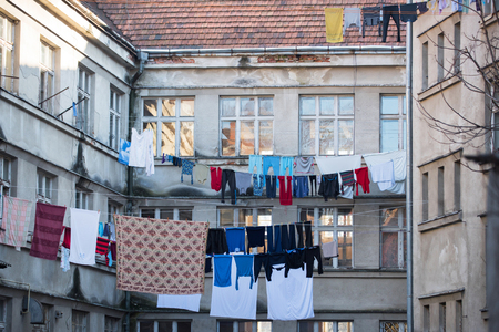 Ecology, eco, environment. Clothes hang on clothesline at house backyard. Laundry, garment, linen dry on air outdoor. Stok Fotoğraf