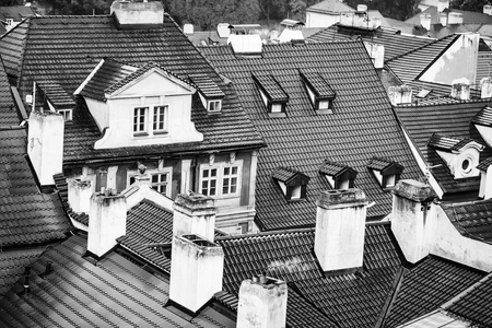 Terracotta tiled roofs with chimneys and dormer windows of city or town houses buildings on roofscape background Stok Fotoğraf - 93444753