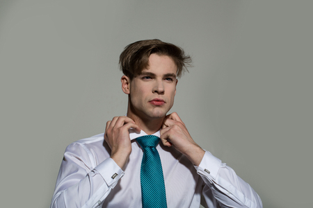 Businessman tie necktie on grey background. Business fashion, accessory, style concept