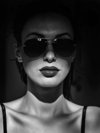young cute sexy woman or girl portrait with brown lips on pretty face has fashionable makeup in sunglasses sunny day Stock Photo