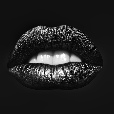 Closeup view of sexual beautiful female open golden lips with white teeth isolated on red background, square picture