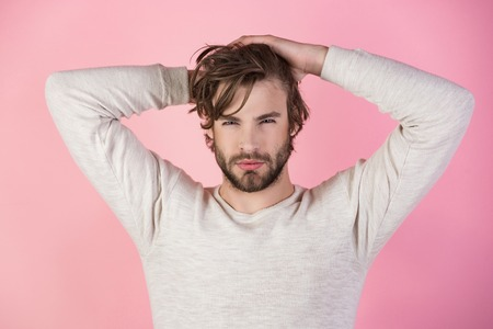 Sleepy man with beard on pink background. Man with disheveled hair in underwear. Barber and hairdresser, male fashion. Morning wake up, everyday life. Insomnia, energy, single with uncombed hair. Imagens