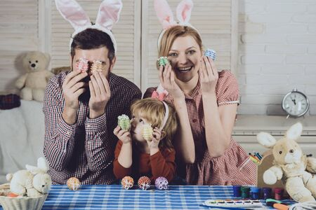 Family values, childhood, art, easter. happy family of mother, father and child at easter.