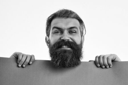 bearded man, long beard, brutal caucasian hipster with moustache on happy smiling face, unshaven guy with stylish hair getting haircut with violet paper sheet isolated on white background, copy space Reklamní fotografie