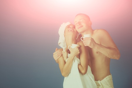 Couple in love of man and woman in bath. couple in love with morning coffee, copy space, vintage