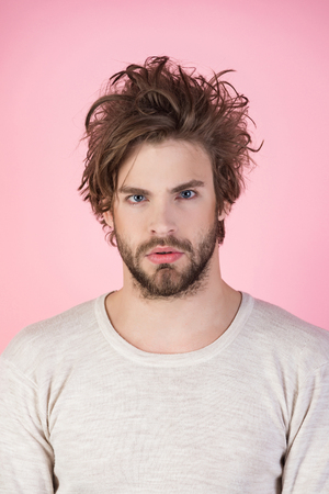 Man with disheveled hair in underwear. Sleepy man with beard on pink background. Morning wake up, everyday life. Barber and hairdresser, male fashion. Insomnia, energy, single with uncombed hair.